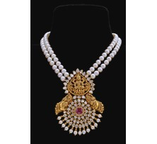 Two layer pearl necklace with gold Lakshmi pendant