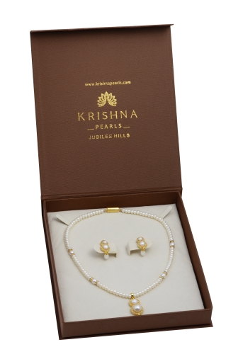 Pearls, White czs necklace and earrings set.